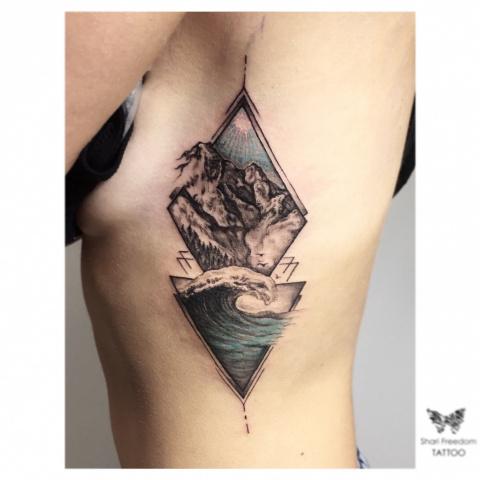 tetování hory a les